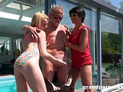Wild outdoors FFM threesome with a mature and a teen slut