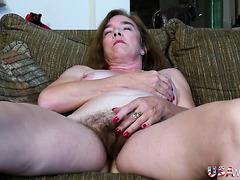 Lots of sexy pubic hair on a masturbating mature slut