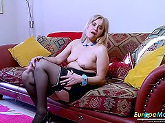 Mature European slut fingers and toy fucks her cunt solo