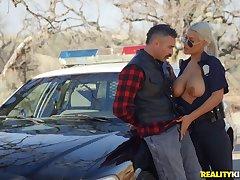 Gaffer female cop treats herself encircling a big dick