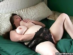 Large-Breasted granny takes manipulation of her throbbing clit