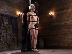 Unreasoned dude fucks tied around sexy blonde Helena Locke in a difficulty dark basement