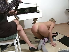 Piano teacher punishes her partisan and fucks her fro a strap on dildo