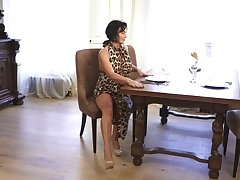 A bit buxom housewife Olivia Westervelt gets denuded and masturbates on the table