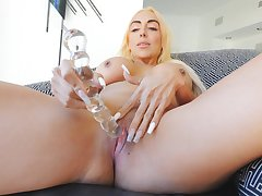 Aroused blonde pushes the glass toy as abyss as possible