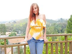 Cute redhead neonate Holly flashes her botheration and pair in outdoors